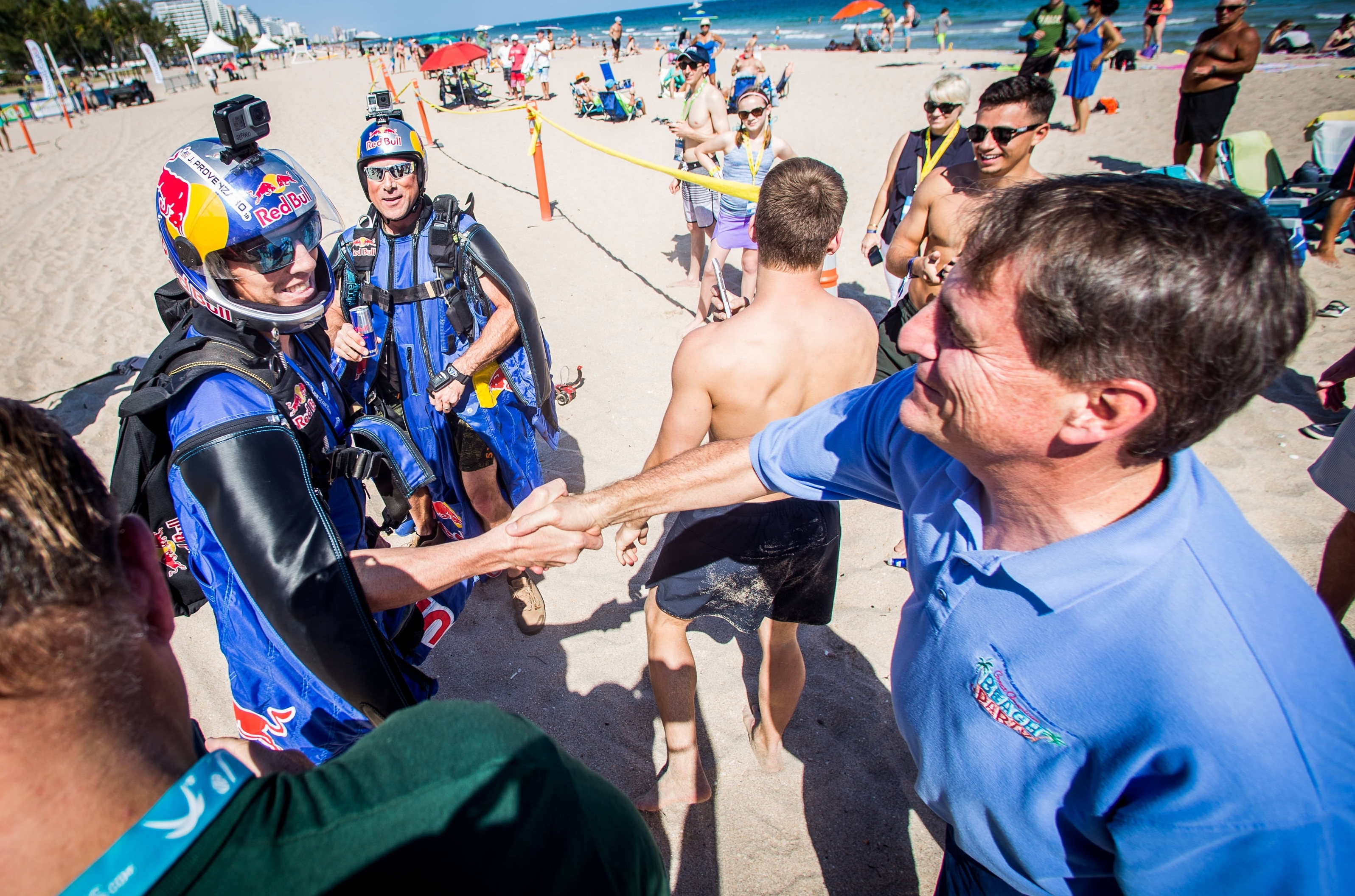 Fort Lauderdale Major, Jack Seiler (right) congratulates the Red Bull Air Force team following their descent to the Center Court at the Fort Lauderdale Major. Photocredit: Ian Witlen