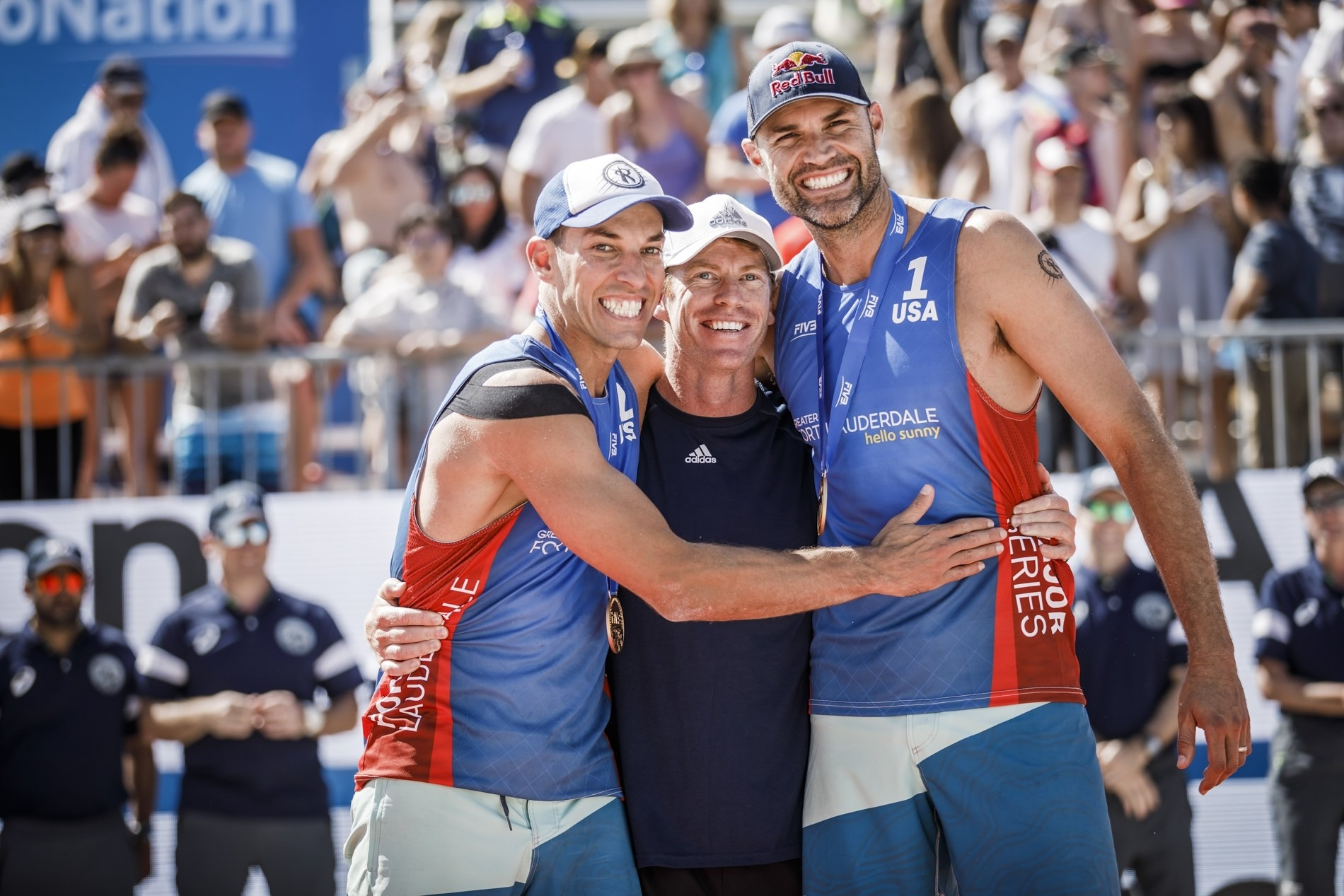The stronger the team, the stronger the team: Nick and Phil with coach Jason Lochhead (center)